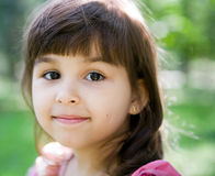 Beautiful curious girl  in a park Stock Photo