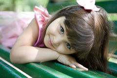 Beautiful curious girl  in a park Stock Image