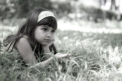Beautiful curious girl  in a park Royalty Free Stock Image