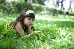 Beautiful curious girl  in a  park Royalty Free Stock Photography