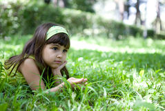 Beautiful curious girl  in a summer park Stock Images
