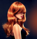 Beautiful curl. Fashion Girl with beautiful curl and shiny red hair royalty free stock photos