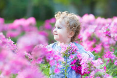 Beautiful Curly Baby Girl Playing In The Garden Royalty Free Stock Images