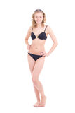 Beautiful curly blonde in black swimsuit with player Stock Photography