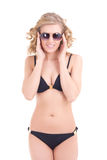 Beautiful curly blonde in black swimsuit and sunglasses Stock Images