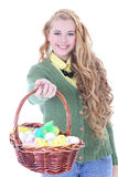 Beautiful curly blondie girl with easter eggs in the basket over Royalty Free Stock Photo