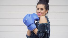 Stylish woman in dress posing for camera in boxing gloves stock video