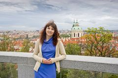 Beautiful woman on an excursion in Prague. Beautiful curly brunette woman on an excursion in Prague, Czech Republic Royalty Free Stock Photo