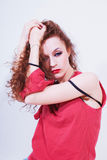 Beautiful curly brunette woman in red T-shirt Royalty Free Stock Photo
