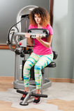 Beautiful curly female exercising at fitness club Stock Photo