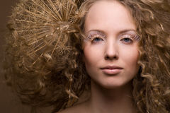 Beautiful curly girl. Portrait of beautiful curly girl on a beige background Stock Photos