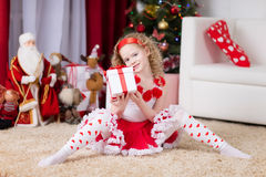 Beautiful curly girl with Christmas giftbox Stock Photo