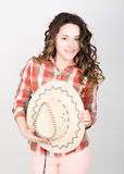 Beautiful curly girl in pink pants, a plaid shirt and cowboy hat. Royalty Free Stock Images