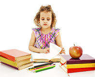 Beautiful curly girl with school books on the table Royalty Free Stock Photography