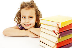 Beautiful curly girl with school books on the table Stock Images