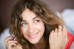 Beautiful curly girl smiling and looking away Stock Images