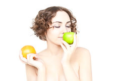 Beautiful curly girl with two fruits Royalty Free Stock Photography