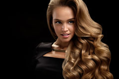 Beautiful Curly Hair. Female Beauty Model With Volume Hair. Beautiful Curly Hair. Female Beauty Model With Perfect Makeup, Gorgeous Volume And Blonde Hair Color royalty free stock image