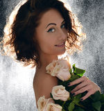 Beautiful curly hair woman with bouquet of wild roses flowers wi Stock Photo