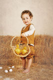 Beautiful Curly-haired Boy Holding Ducklings In A Basket Royalty Free Stock Images