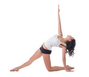 Beautiful curly-haired woman exercising pilates Stock Photography