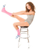 Beautiful curly haired woman sitting on the bar chair Stock Photography