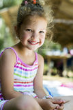 Beautiful curly haired young girl smiling Stock Photography