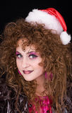 Beautiful curly-headed Santa-girl Royalty Free Stock Photo