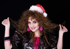Beautiful curly-headed Santa-girl Royalty Free Stock Images
