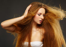 Beautiful curly red-haired woman Stock Photos
