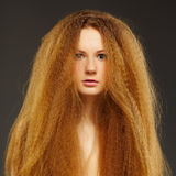 Beautiful curly red-haired woman Royalty Free Stock Images