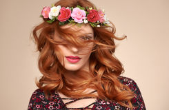 Beautiful Curly Redhead in Fashion Flower Wreath. Fashion Beautiful Curly Redhead Portrait in Flower Wreath. Shiny Curly flower fashion Volume Hairstyle. Happy royalty free stock photos