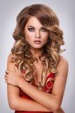 Beautiful, curly woman Stock Photos