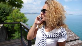 Beautiful Curly Woman Talking on Cell Phone stock footage