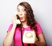 Beautiful curly woman  talking on white vintage telephone Royalty Free Stock Images
