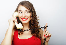 Beautiful curly woman  talking on white vintage telephone Royalty Free Stock Photos