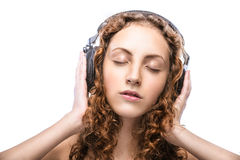 Beautiful curly young woman with headphones Royalty Free Stock Photo