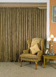 Beautiful curtain and armchair Royalty Free Stock Photos