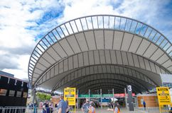 The beautiful curved design of shading roofing at the entrance of Sydney Olympic park train station. royalty free stock images