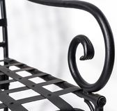 Curved details, structure and ornaments of wrought ir. Beautiful, curved details, structure and ornaments of wrought iron. Close up Royalty Free Stock Images