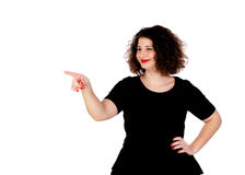 Beautiful curvy girl with black dress indicating something with Royalty Free Stock Photos