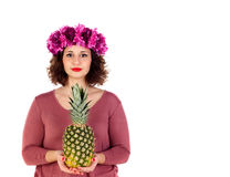 Beautiful curvy girl with a flowered headdress holding and pinea Royalty Free Stock Images