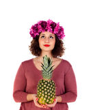 Beautiful curvy girl with a flowered headdress holding and pinea Stock Photo
