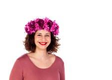 Beautiful curvy girl with a flowered headdress wiking a eye Stock Image