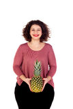 Beautiful curvy girl holding and pineapple wiking a eye Stock Images