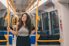 Beautiful curvy girl posing in a metro car Royalty Free Stock Photos