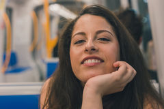 Beautiful curvy girl posing in a metro car Stock Photography