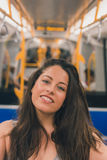 Beautiful curvy girl posing in a metro car. Beautiful young curvy girl in tank top posing in a metro car Stock Images