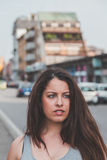 Beautiful curvy girl posing in an urban context Royalty Free Stock Image