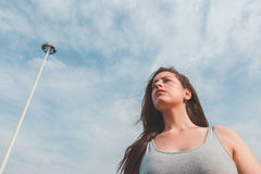 Beautiful curvy girl posing in an urban context Royalty Free Stock Photos